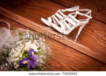 bridal bouquet posy with wedding shoes - stock photo