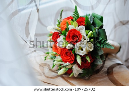 bridal bouquet with roses and lace - stock photo