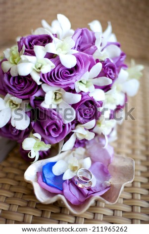 Bridal bouquet with wedding rings in seashell - stock photo