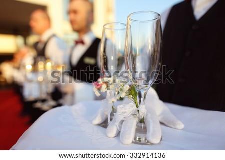 Bridal couple toasting glasses of champagne - stock photo