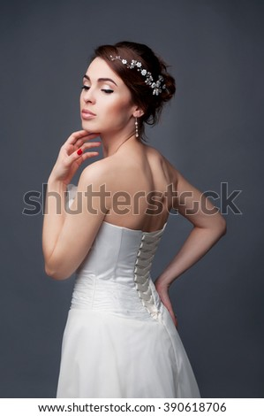 Bridal fashion, hairstyle and makeup. Brunette bride in wedding dress and beaded headpiece. - stock photo