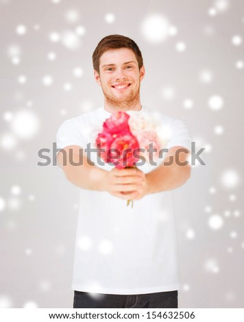 bridal, floral, holidays concept - handsome young man holding bouquet of flowers - stock photo