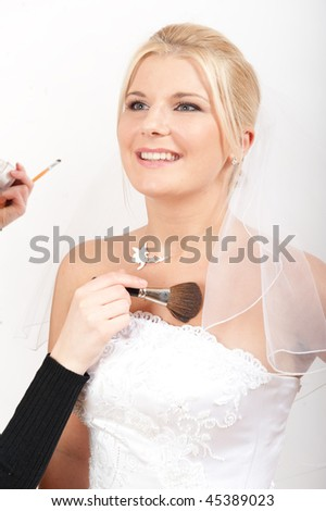 Bridal make up on young pretty bride in white wedding dress - stock photo