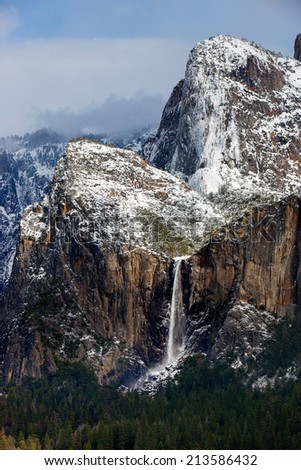 Bridalveil Falls and Cathedral Spires in winter, Yosemite National Park, California. - stock photo