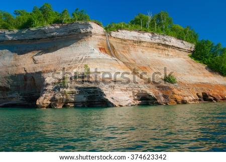 Bridalveil Falls cascades down the Pictured Rocks, Michigan, USA - stock photo