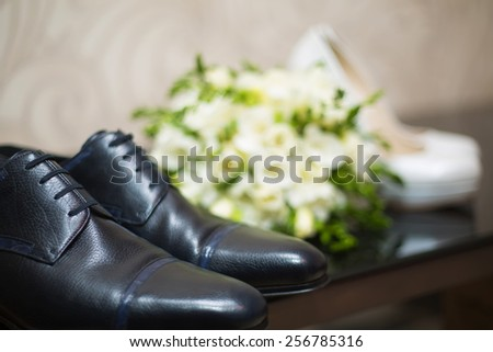 Bride's and groom's shoes on parquet. wedding background - stock photo
