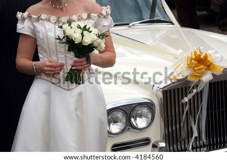Bride and a classical car - stock photo