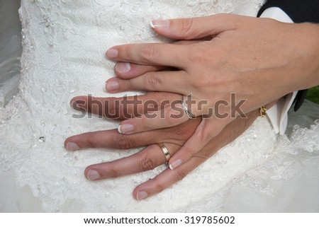 Bride and a groom holding hands at wedding day - stock photo