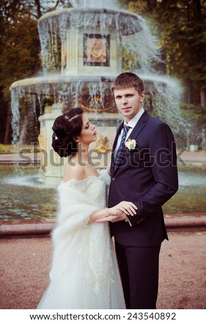 Bride and groom against fountain
