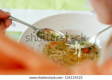 Bride and groom are eating at the wedding reception - stock photo