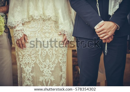 Bride And Groom At Jewish Wedding Ceremony Standing Side By