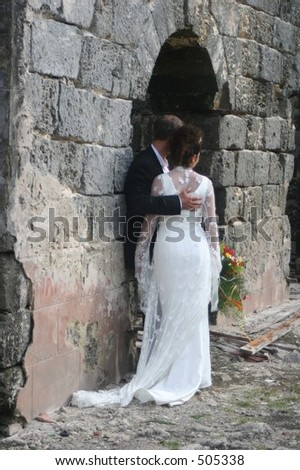 Bride and Groom at Old Stone Structure - stock photo