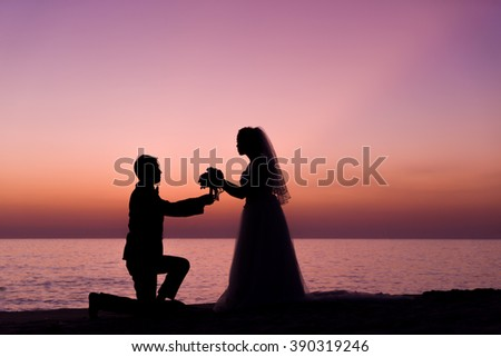 Bride and Groom at Sunset Romantic Married Couple at the beach - stock photo