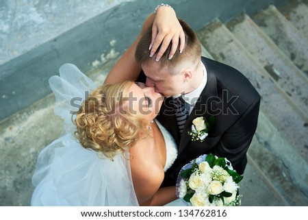 Bride and groom at the stairs - stock photo