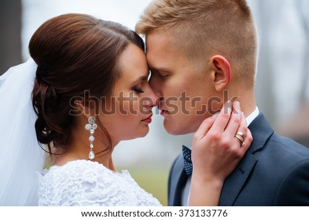 Bride and groom at wedding day outdoors. Newlyweds man and woman. Happy couple at wedding day. funny wedding details. soft tonality