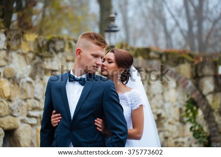 Bride and groom at wedding day outdoors. Newlyweds man and woman. Happy couple at wedding day.