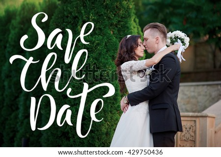 Bride and groom at wedding Day walking Outdoors on spring park words Save the Date - stock photo