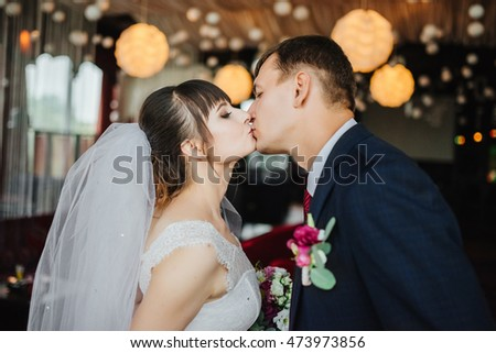 Bride and groom at wedding Day. Wedding photo session in interior. Bridal couple, Happy Newlywed woman and man embracing. Romantic wedding.