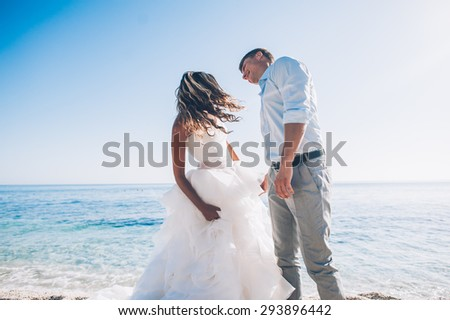 Bride and groom by the sea on their wedding day