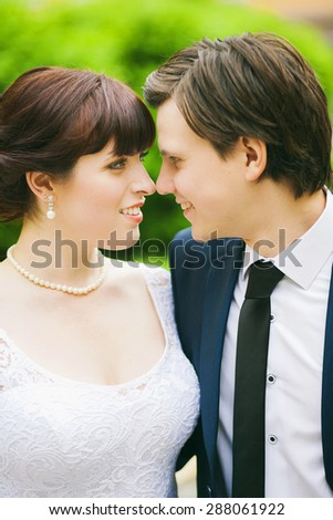 Bride and groom close up portraits. Man and woman face to face. Smiling happy  - stock photo
