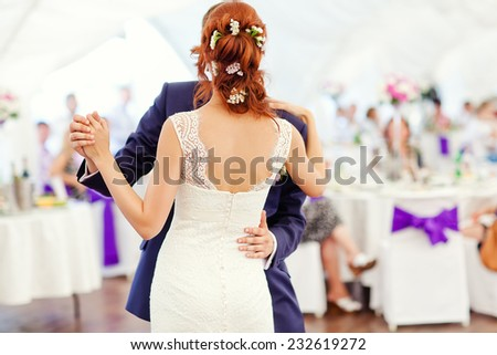 Bride and groom dancing at wedding reception. - stock photo