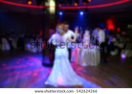 bride and groom dancing in the restaurant, abstract blurred colourful photography