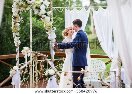 Bride and groom dancing the first dance at the wedding ceremony. - stock photo