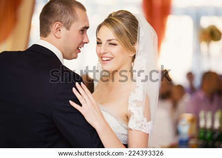 Bride and groom dancing the hall - stock photo