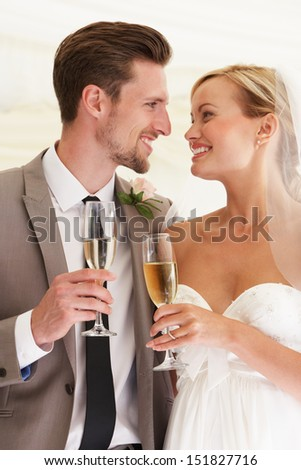 Bride And Groom Drinking Champagne At Wedding - stock photo