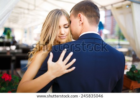 Bride and groom embracing on your wedding day