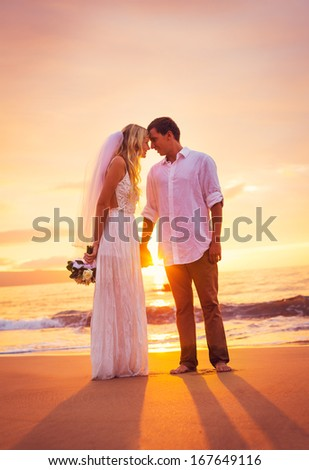Bride and Groom, Enjoying Amazing Sunset on a Beautiful Tropical Beach, Romantic Married Couple Holding Hands, Just Married - stock photo