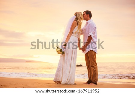 Bride and Groom, Enjoying Amazing Sunset on a Beautiful Tropical Beach, Romantic Married Couple Holding Hands - stock photo