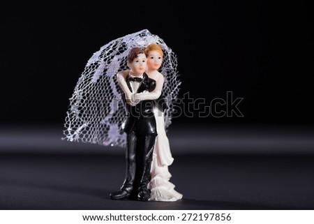 Bride and groom figures as wedding invitation - stock photo