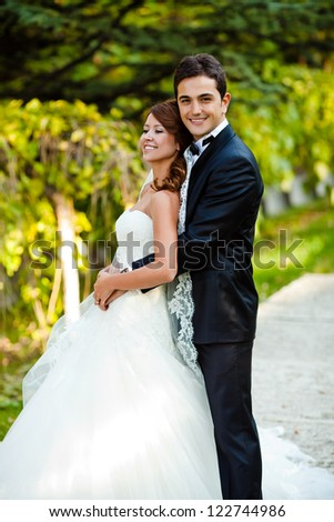 bride and groom for wedding at a park - stock photo