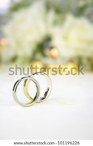 Bride and groom gold and white gold wedding rings