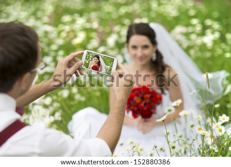 Bride and groom having fun in nature - stock photo