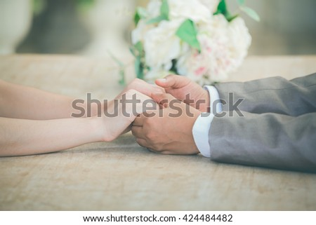 bride and groom holding hands a symbol of love and weddings - stock photo