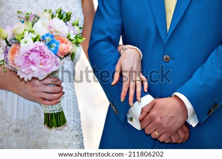 bride and groom holding hands on wedding ceremony - stock photo