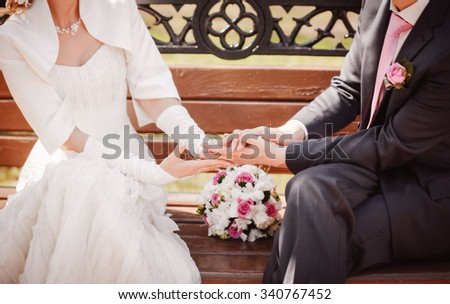 bride and groom holding their arms together - stock photo