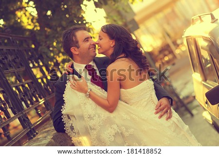 Bride and groom hugging in the city - stock photo