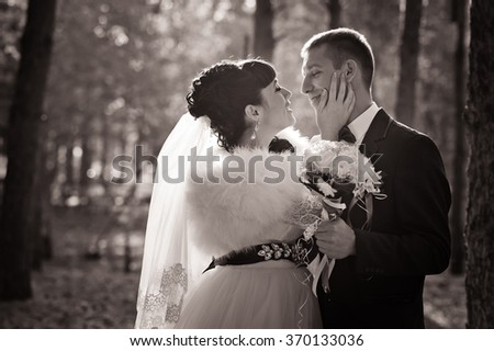 bride and groom in a park in autumn