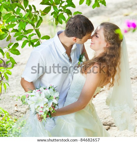 Bride and groom in a tropical garden