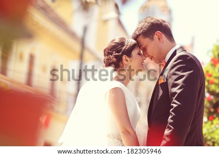 Bride and groom in the city  - stock photo