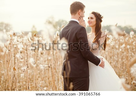 bride and groom in the field with cotton