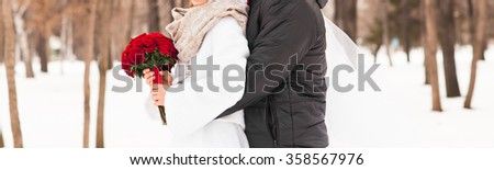 bride and groom in the winter woods