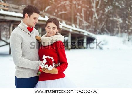 Bride and groom in winter forest
