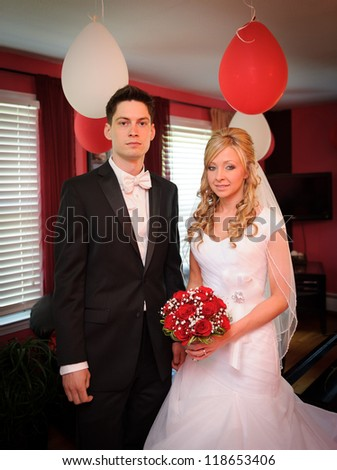 Bride and groom inside of the house - stock photo