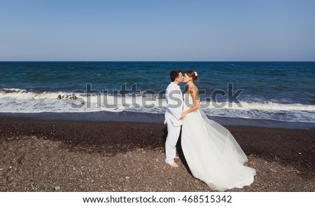 Bride and Groom, Kissing on a Beautiful Tropical Beach,  Romantic Married Couple
