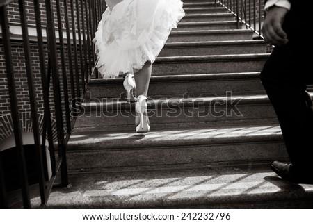 Bride and groom legs walking away  - stock photo
