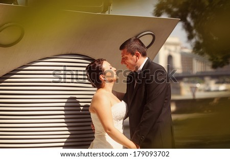 Bride and groom looking at each other  - stock photo
